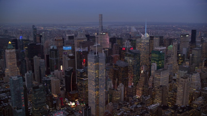 6K stock footage aerial video orbit Midtown skyscrapers at twilight in New York City Aerial Stock Footage | AX121_087