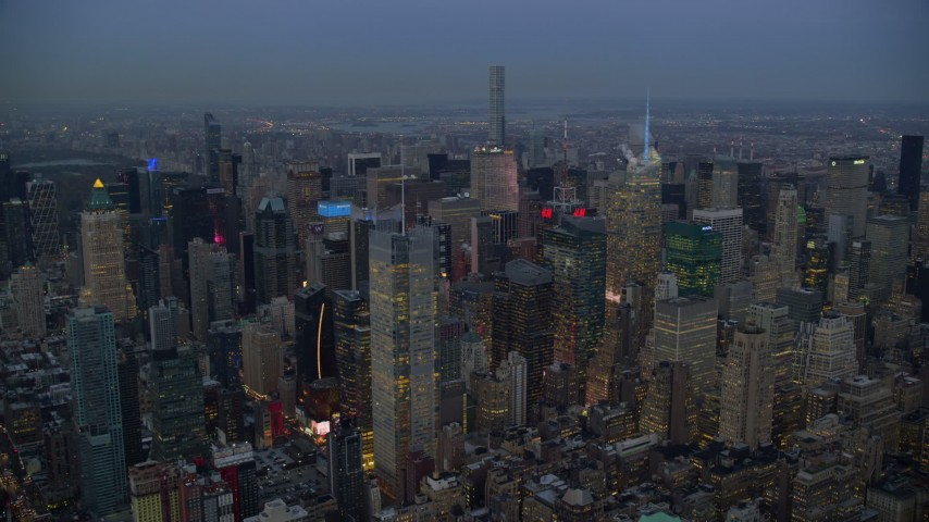 5.5K stock footage aerial video orbit Midtown skyscrapers at twilight in New York City Aerial Stock Footage | AX121_087E