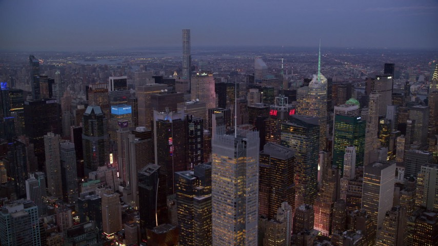 6K stock footage aerial video orbit skyscrapers in Midtown Manhattan at twilight, New York City Aerial Stock Footage | AX121_088