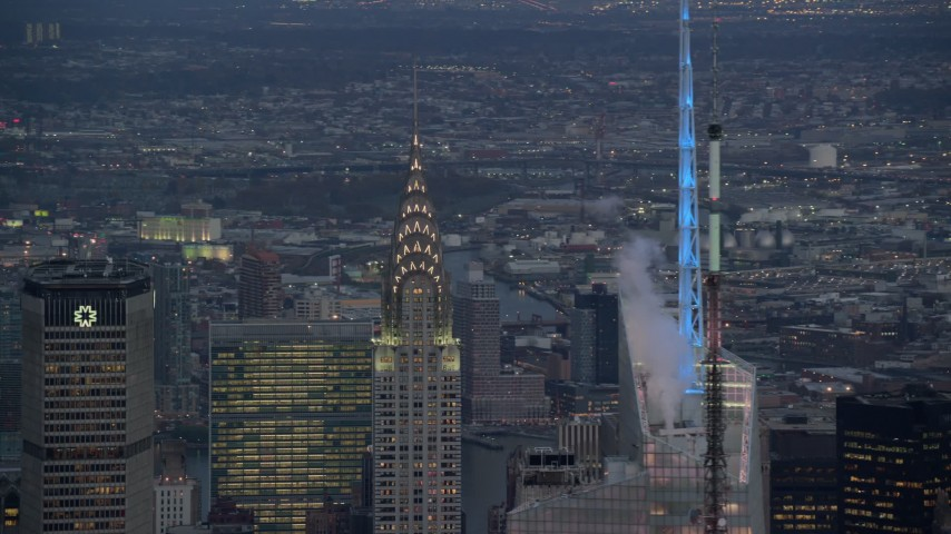 5.5K stock footage aerial video orbit top of Chrysler Building at twilight in Midtown, New York City Aerial Stock Footage | AX121_089E