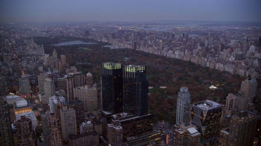 6K stock footage aerial video approach Time Warner Center and Central Park at twilight in New York City Aerial Stock Footage | AX121_091
