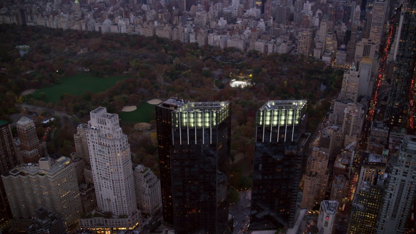 Orbit Time Warner Center and Central Park at twilight in New York City Aerial Stock Footage | AX121_092