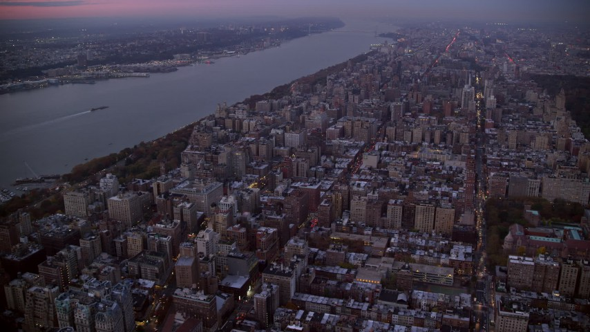 6K stock footage aerial video of apartment buildings on the Upper West Side at twilight in New York City Aerial Stock Footage | AX121_093