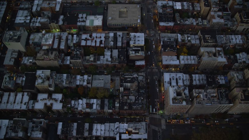 6K stock footage aerial video of a bird's eye of row houses and streets on the Upper West Side at twilight, New York City Aerial Stock Footage | AX121_095