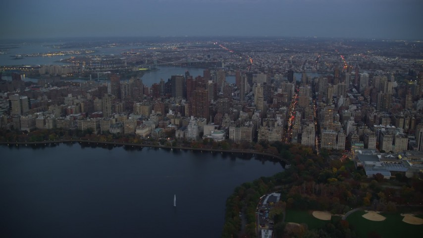 6K stock footage aerial video orbit Upper East Side skyscrapers near Central Park at twilight in New York City Aerial Stock Footage | AX121_096