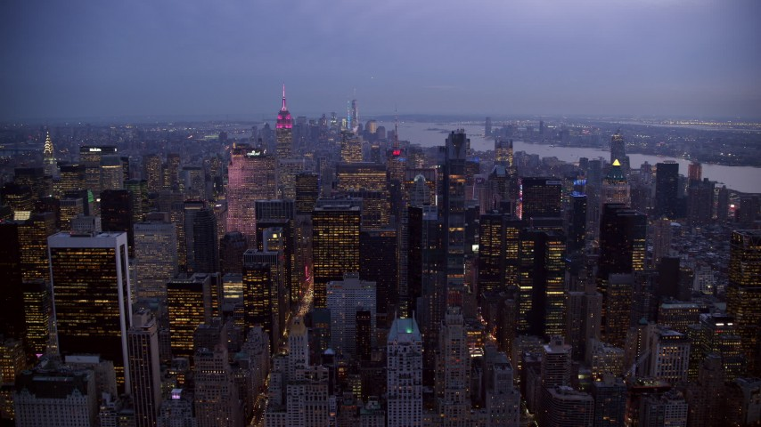 Approach Midtown from Central Park at twilight in New York City Aerial Stock Footage | AX121_101