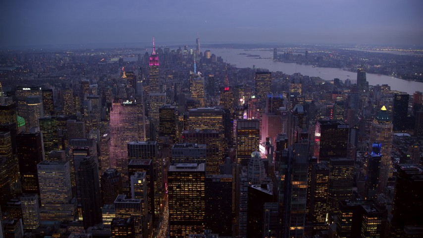 6K stock footage aerial video fly over Midtown near Times Square at twilight in New York City Aerial Stock Footage | AX121_102