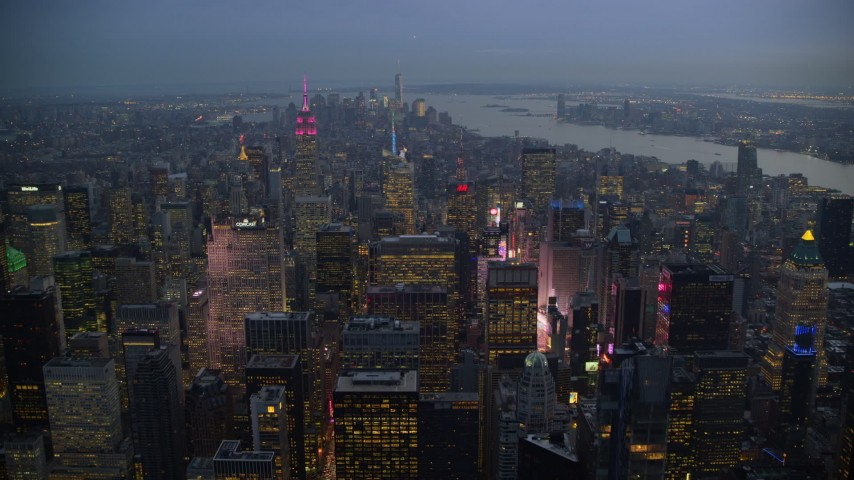5.5K stock footage aerial video fly over Midtown near Times Square at twilight in New York City Aerial Stock Footage | AX121_102E