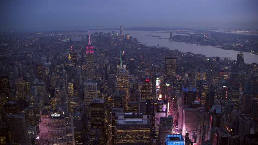 6K stock footage aerial video of Lower Manhattan seen from Midtown at twilight in New York City Aerial Stock Footage | AX121_104