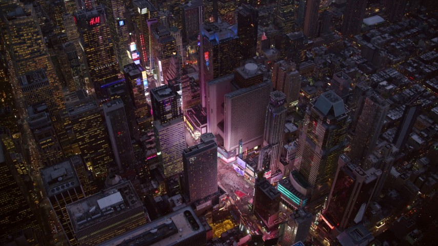 6K stock footage aerial video of bright lights of Times Square at twilight in Midtown, New York City Aerial Stock Footage | AX121_105
