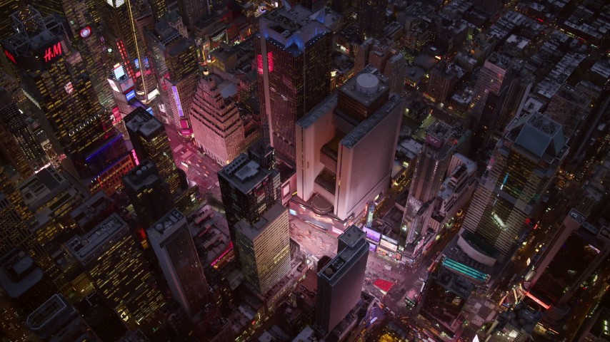 6K stock footage aerial video of bird's eye orbit over Times Square at twilight in Midtown, New York City Aerial Stock Footage | AX121_106