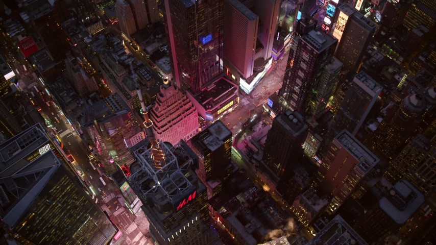 6K stock footage aerial video a bird's eye orbit of Times Square at twilight in Midtown Manhattan, New York City Aerial Stock Footage | AX121_107
