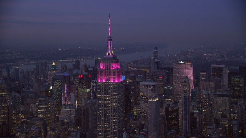 6K stock footage aerial video of the Empire State Building at twilight in Midtown, New York CIty Aerial Stock Footage | AX121_111