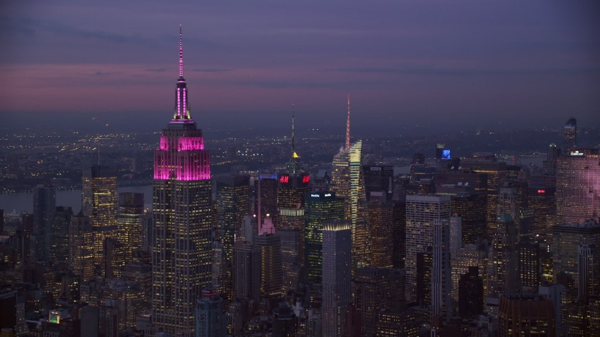 Orbit the Empire State Building at twilight in New York City Aerial Stock Footage | AX121_112