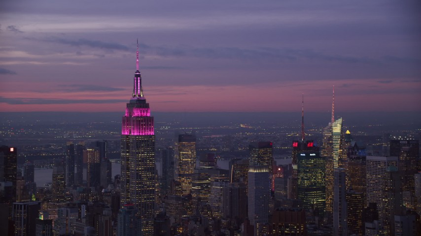 6K stock footage aerial video of circling around the Empire State Building at twilight in Midtown, New York City Aerial Stock Footage | AX121_113