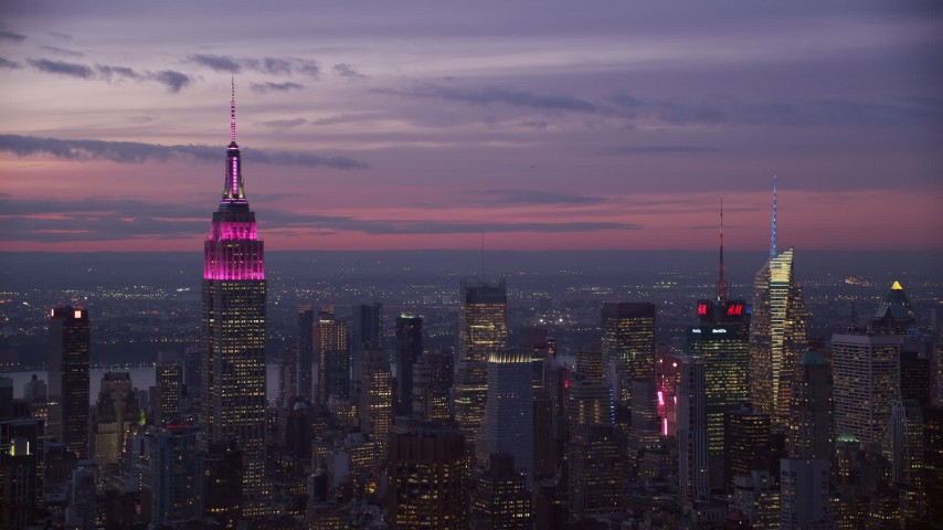 6K stock footage aerial video of Empire State Building and Midtown high-rises at twilight, New York City Aerial Stock Footage | AX121_114