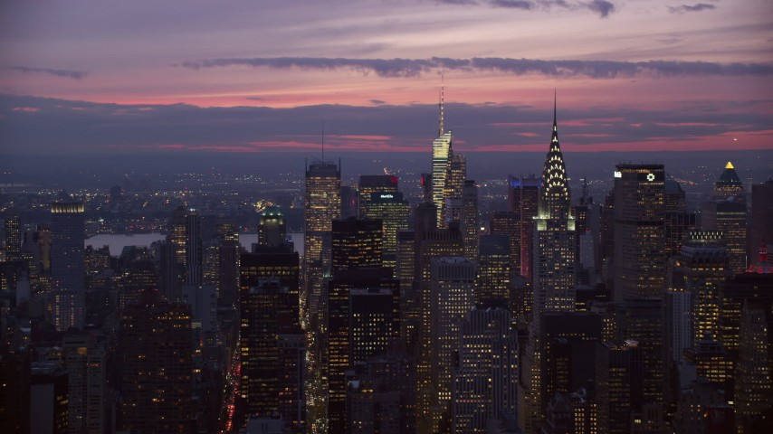 Chrysler Building at twilight in Midtown Manhattan Aerial Stock Footage | AX121_116