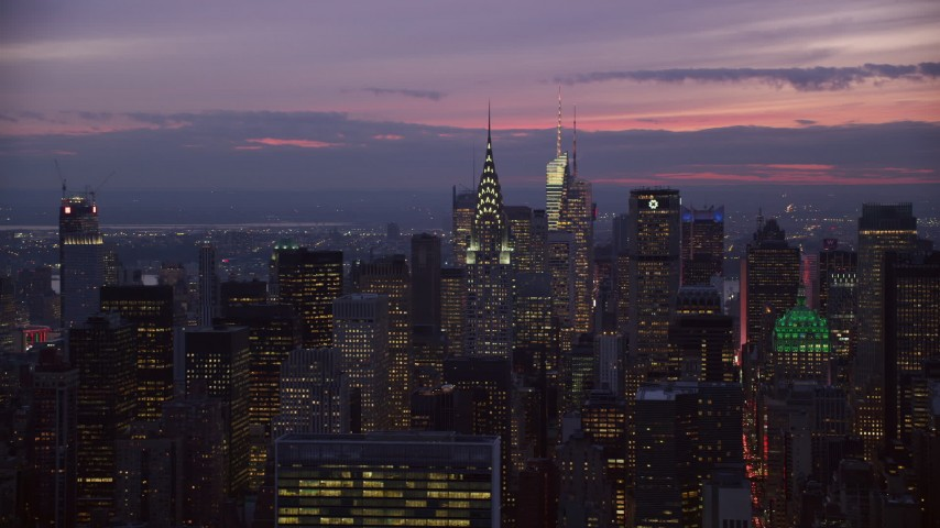 6K stock footage aerial video orbit Chrysler Building and Midtown high-rises at twilight in New York City Aerial Stock Footage | AX121_117