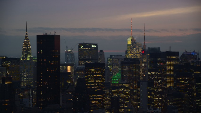 6K stock footage aerial video of Midtown skyscrapers at twilight in New York City Aerial Stock Footage | AX121_118