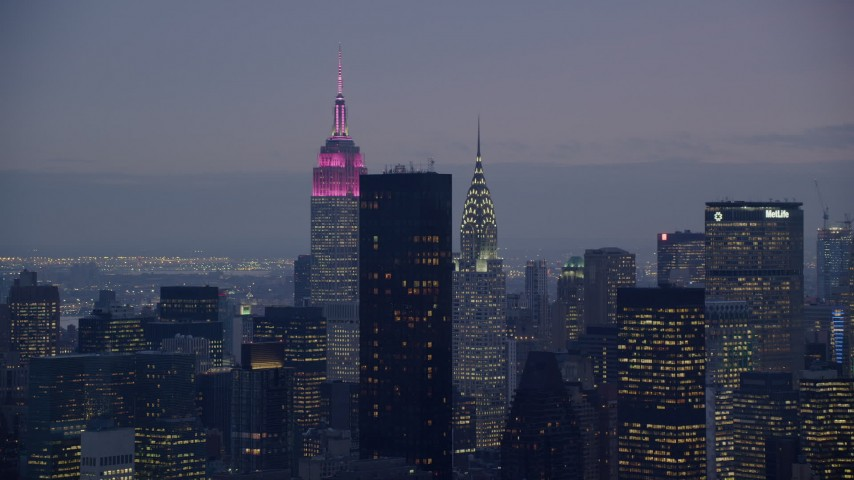 6K stock footage aerial video of Empire State and Chrysler Buildings at twilight in Midtown, New York City Aerial Stock Footage | AX121_119