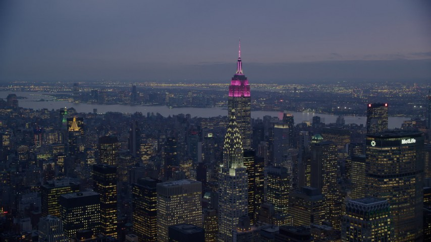 6K stock footage aerial video of the Empire State and Chrysler Buildings at twilight in New York City Aerial Stock Footage | AX121_124