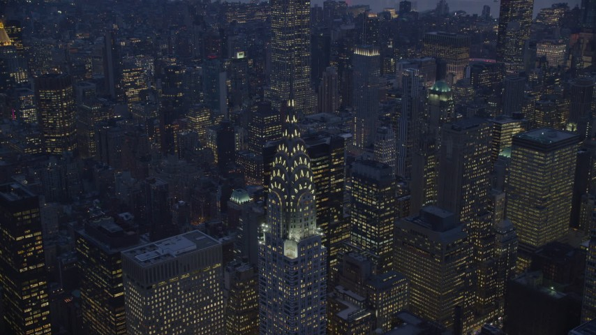 6K stock footage aerial video approach the Chrysler Building at twilight in New York City Aerial Stock Footage | AX121_125