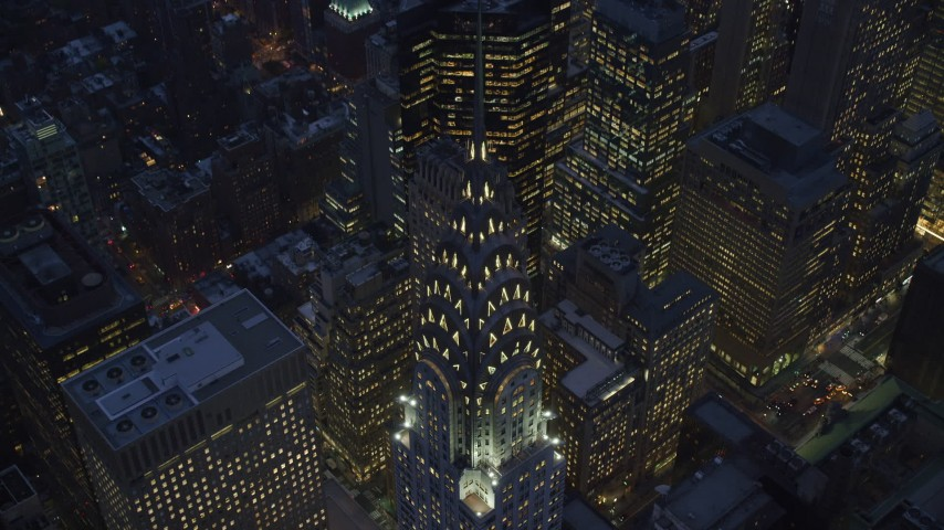 6K stock footage aerial video tilt to bird's eye of Chrysler Building at twilight in Midtown Manhattan Aerial Stock Footage | AX121_126