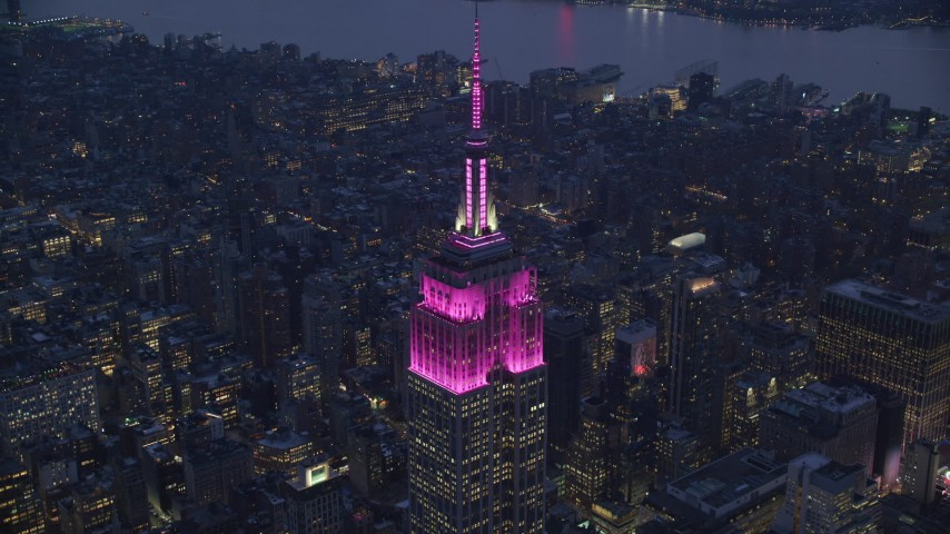 6K stock footage aerial video approach Empire State Building at twilight in Midtown, New York City Aerial Stock Footage | AX121_127