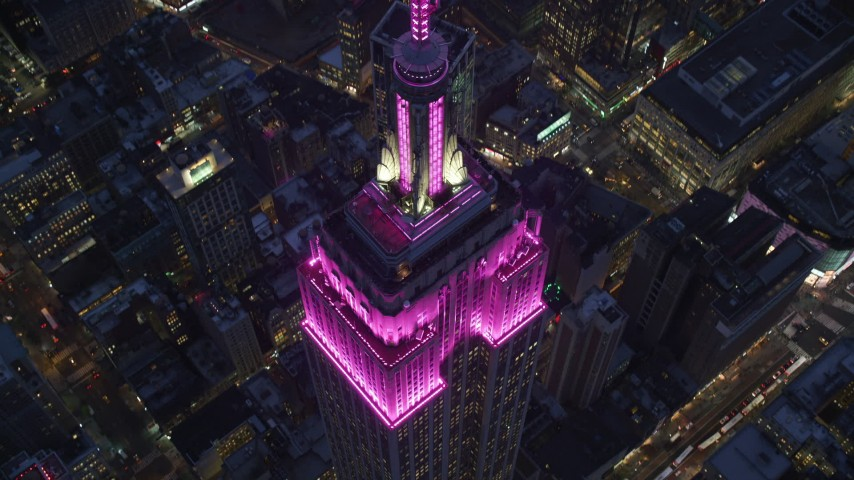 Tilt Down to Bird's Eye of Empire State Building at twilight in Midtown Aerial Stock Footage | AX121_128