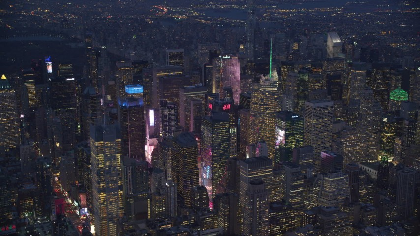 6K stock footage aerial video orbit Midtown skyscrapers at night in New York City Aerial Stock Footage | AX121_130