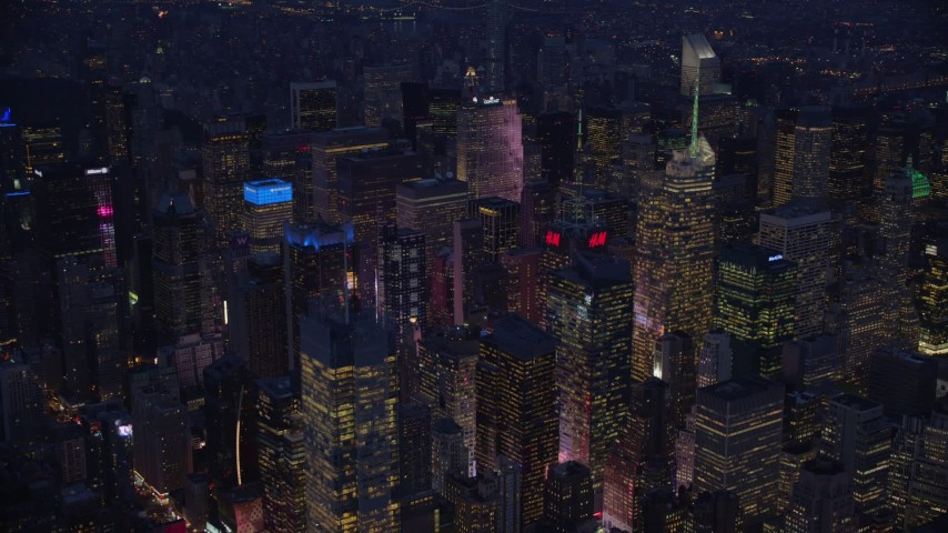 5.5K stock footage aerial video orbit Midtown skyscrapers at night in New York City Aerial Stock Footage | AX121_130E