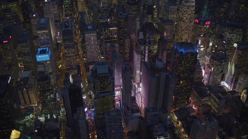 6K stock footage aerial video orbit Times Square and high-rises at Night in Midtown, New York City Aerial Stock Footage | AX121_133