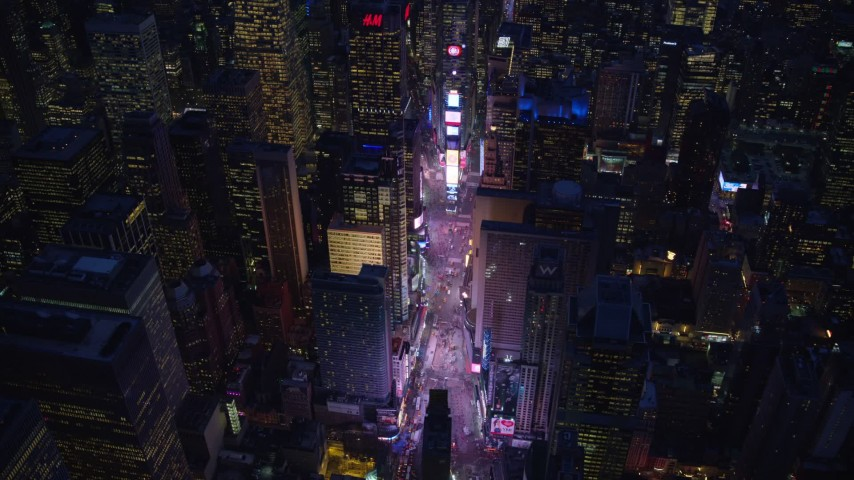 5.5K stock footage aerial video orbit Times Square and high-rises at Night in Midtown, New York City Aerial Stock Footage | AX121_133E