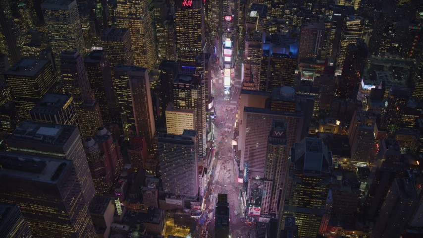 6K stock footage aerial video approach Times Square at Night in New York City Aerial Stock Footage | AX121_135