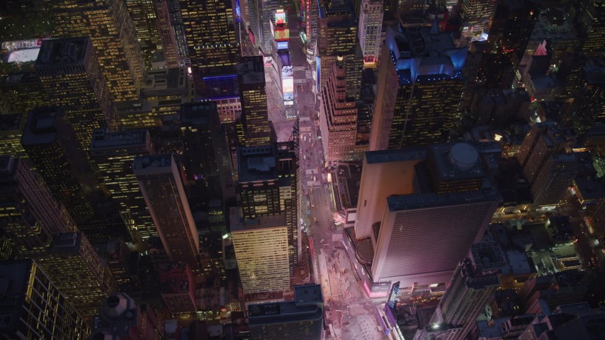 6K aerial video of a bird's eye orbit of Times Square at Night in New York City Aerial Stock Footage | AX121_136