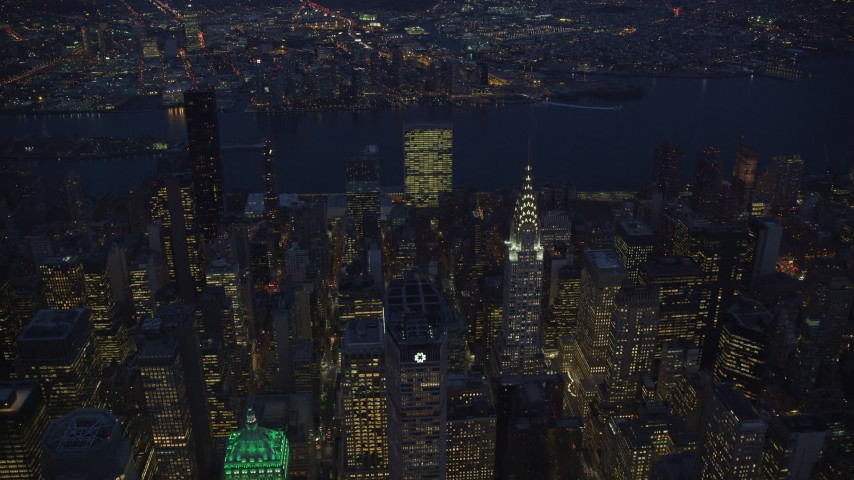 6K stock footage aerial video approach Chrysler Building at Night in New York City Aerial Stock Footage | AX121_137