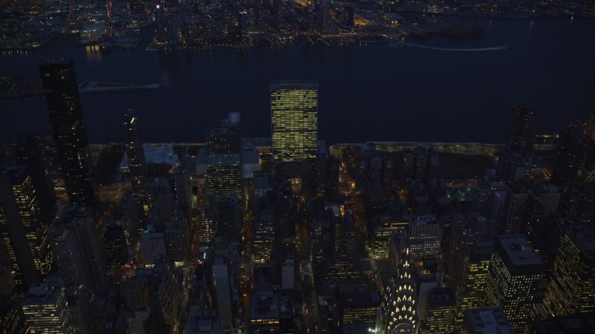 Approach United Nation at Night in New York City Aerial Stock Footage   AX121_138