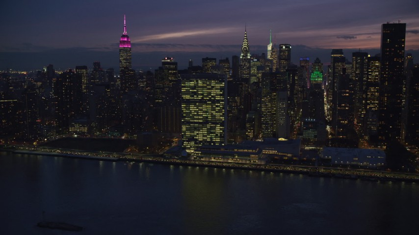 Approach the UN Building in Midtown at Night in New York City Aerial Stock Footage   AX121_145
