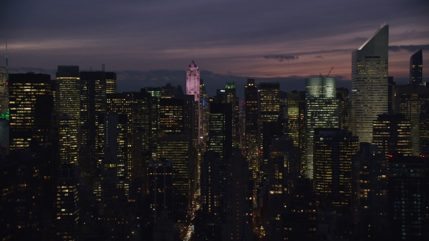 6K aerial video flyby city canyons in Midtown at Night, New York City Aerial Stock Footage | AX121_149