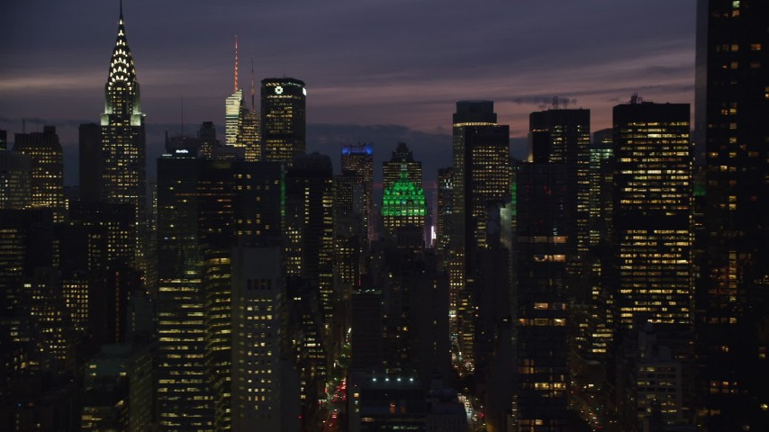 6K stock footage aerial video flyby streets and high-rises at Night in Midtown, New York City Aerial Stock Footage | AX121_150