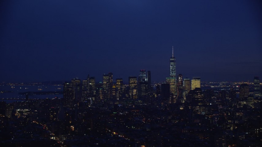 5.5K stock footage aerial video approach Lower Manhattan skyline at Night in New York City Aerial Stock Footage | AX121_153E