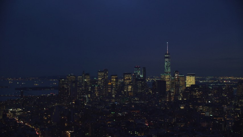 6K stock footage aerial video of the skyline of Lower Manhattan at Night, New York City Aerial Stock Footage | AX121_154