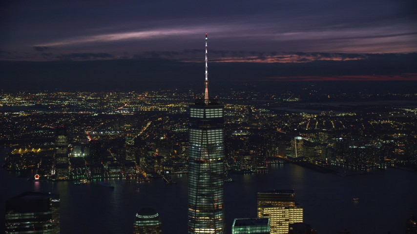 6K stock footage aerial video of slowly orbiting One World Trade Center in downtown at Night in New York City Aerial Stock Footage | AX121_162