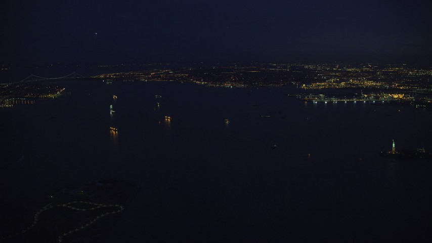 6K stock footage aerial video slowly approach ships in New York Harbor at Night Aerial Stock Footage   AX121_166