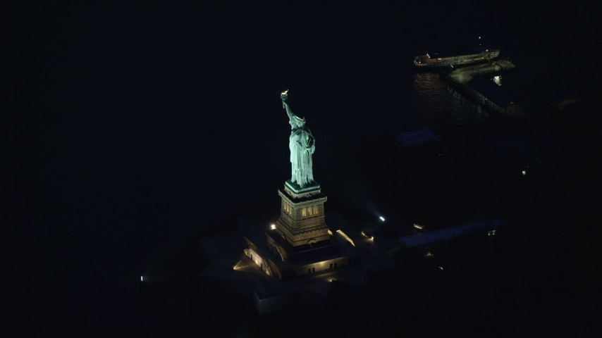 6K stock footage aerial video orbit the Statue of Liberty at Night in New York Aerial Stock Footage | AX121_167