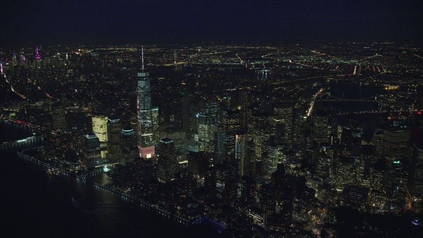 6K stock footage aerial video approach Freedom Tower and Lower Manhattan, New York City at Night Aerial Stock Footage | AX121_173