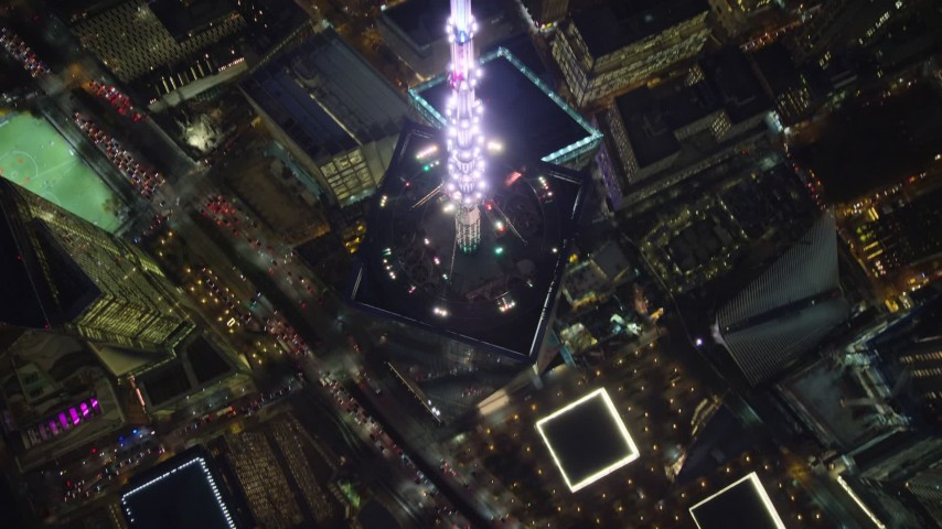 6K stock footage aerial video approach top spire of Freedom Tower and tilt to bird's eye view at Night in NYC Aerial Stock Footage | AX121_175