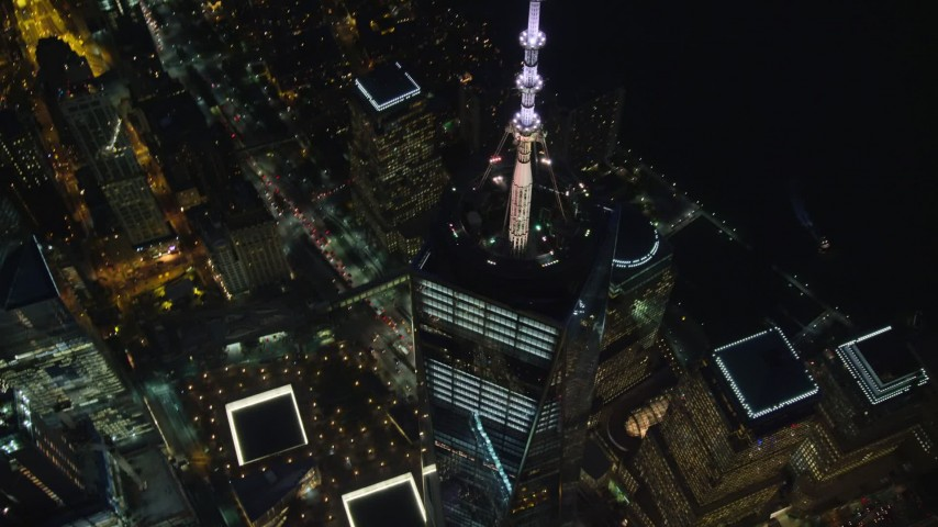 6K stock footage aerial video of flying away from One World Trade Center at Night in Lower Manhattan, New York City Aerial Stock Footage | AX121_176