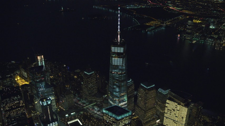 6K stock footage aerial video of approaching top of Freedom Tower at Night in New York City Aerial Stock Footage | AX121_179