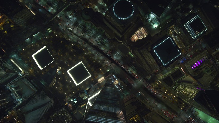 6K stock footage aerial video of a bird's eye view of Freedom Tower and World Trade Center Memorial at Night, New York City Aerial Stock Footage | AX121_181